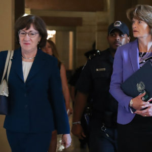 WASHINGTON, DC - OCTOBER 3: (L-R) Sen. Susan Collins (R-ME) and Sen. Lisa Murkowski (R-AK) walk together as they arrive to a closed-door lunch meeting of GOP Senators at the U.S. Capitol, October 3, 2018 in Washington, DC. An FBI report on current allegations against Supreme Court nominee Brett Kavanaugh is expected by the end of this week, possibly later today. (Photo by Drew Angerer/Getty Images)