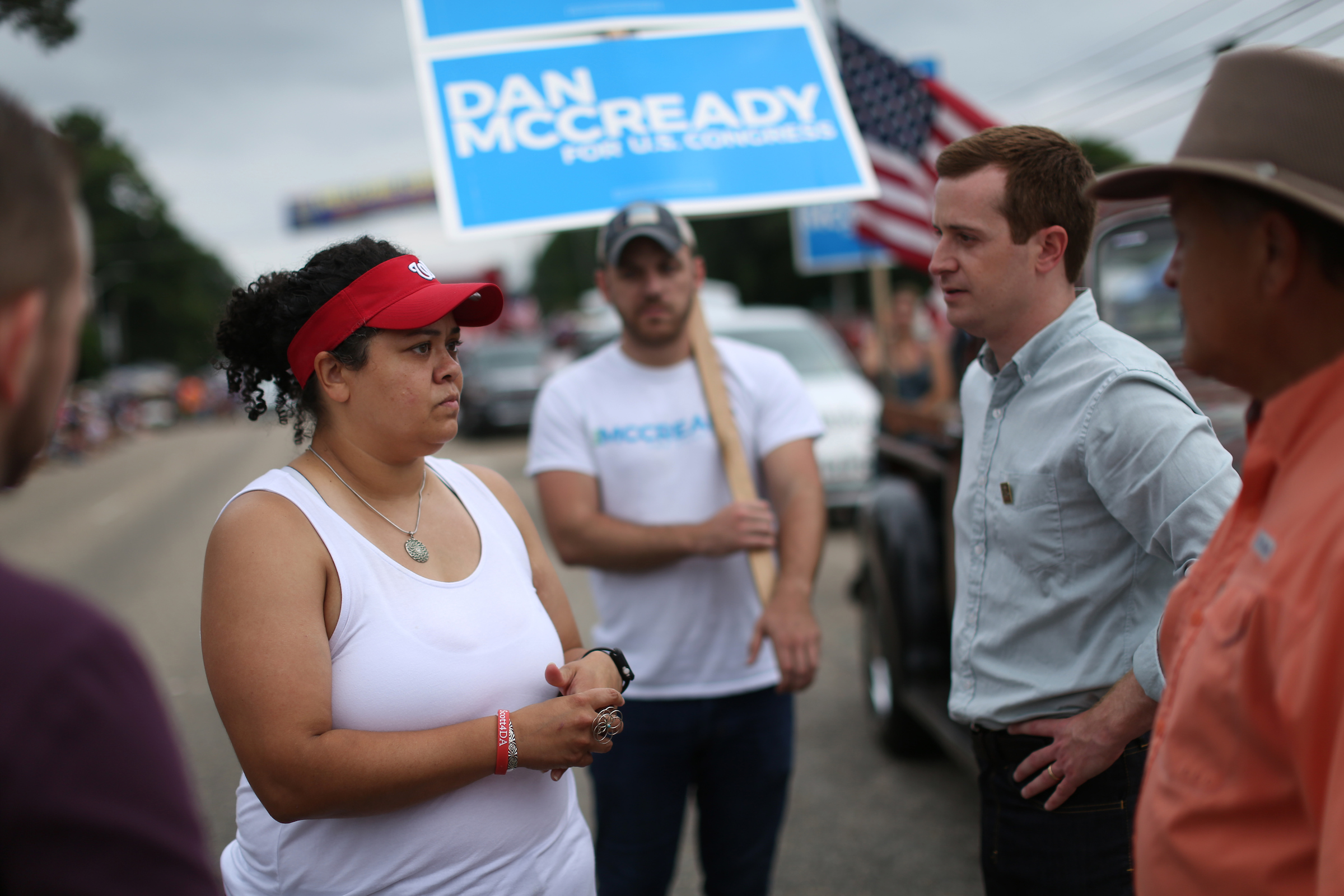 Pembroke, NC Heather McMillan Nakai talks with a congressional candidate, Dan McCready at Lumbee homecoming in Pembroke, NC.