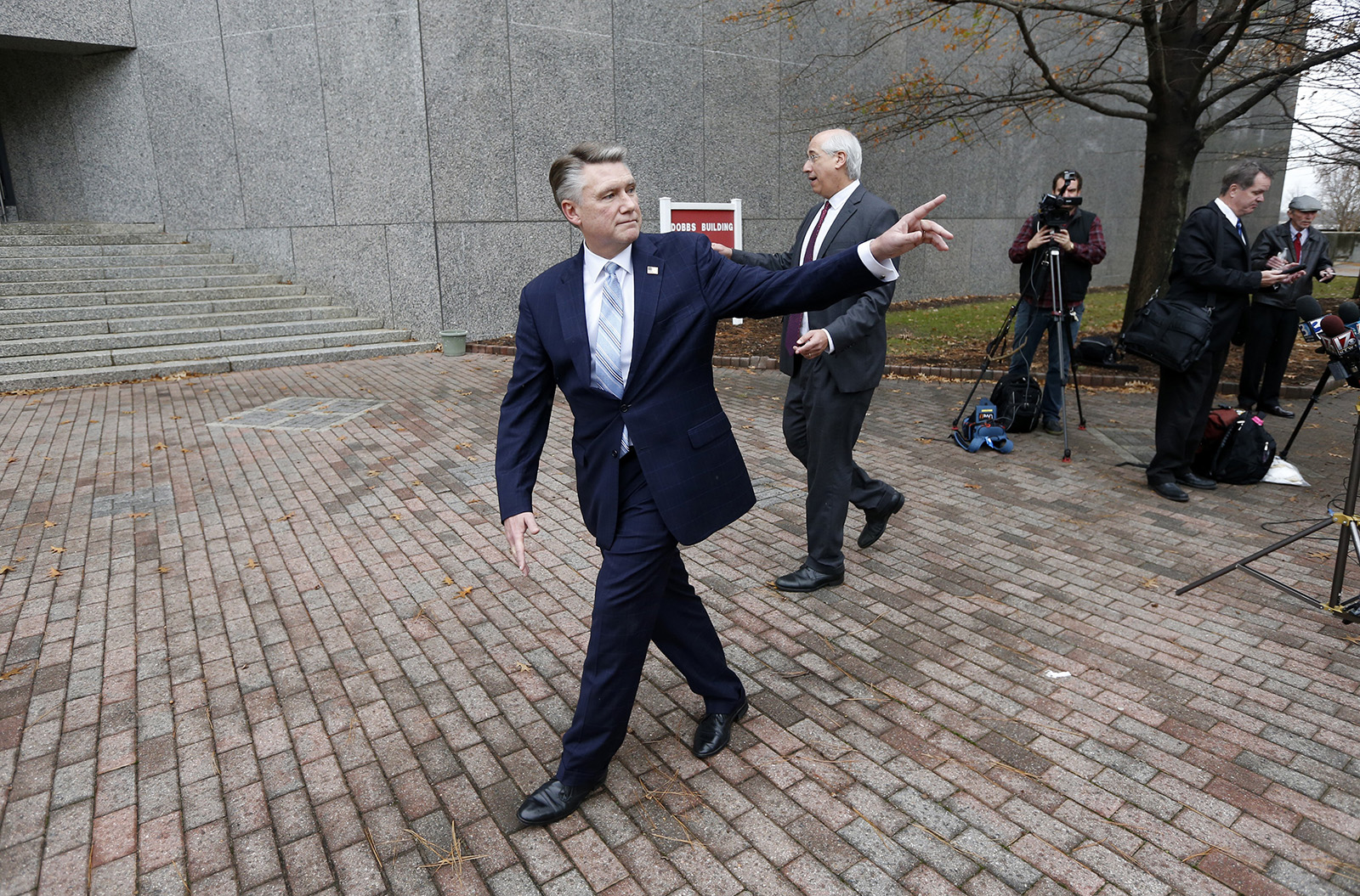 Republican Mark Harris, left, and his attorney David Freedman leave after speaking with the media following a meeting with state election investigators on Thursday, Jan. 3, 2019 at the Dobbs Building in Raleigh, N.C. (Ethan Hyman/Raleigh News & Observer/TNS)
