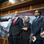 UNITED STATES - JANUARY 10: From left, Sens. Bernie Sanders, I-Vt.,  Cory Booker, D-N.J., Reps. Ilhan Omar, D-Minn., Joe Negues, D-Colo., and Ro Khanna, D-Calif., conduct a news conference in the Capitol to introduce a legislative package that would lower prescription drug prices in the U.S. on January 10, 2019. (Photo By Tom Williams/CQ Roll Call)