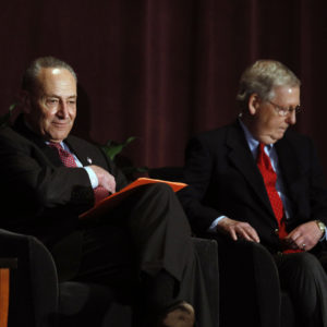 LOUISVILLE, KY-FEBRUARY 12: U.S. Senate Majority Leader Mitch McConnell (right) (R-KY) and U.S. Senate Democratic Leader Chuck Schumer (D-NY) wait on stage together at the University of Louisville's McConnell Center where Schumer was scheduled to speak February 12, 2018 in Louisville, Kentucky. Sen. Schumer spoke at the event as part of the Center's Distinguished Speaker Series, and Sen. McConnell introduced him. (Bill Pugliano/Getty Images)