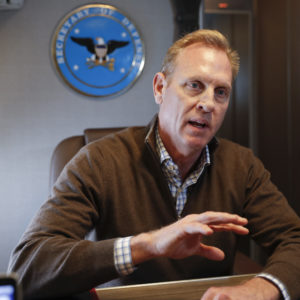 Acting Secretary of Defense Patrick Shanahan gestures while speakings to members of the media aboard a military plane prior to his arrival at Andrews Air Force Base, Md., Saturday, Feb. 23, 2019. Shanahan spoke about the US-Mexico border after visiting the El Paso, Texas area. (AP Photo/Pablo Martinez Monsivais, pool)