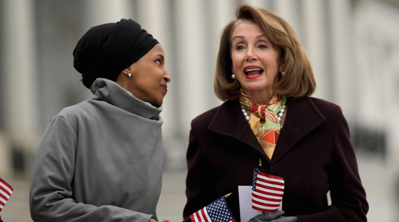 WASHINGTON, DC - MARCH 08: Rep. Ilhan Omar (D-MN) (L) talks with Speaker of the House Nancy Pelosi (D-CA) during a rally with fellow Democrats before voting on H.R. 1, or the People Act, on the East Steps of the U.S. Capitol March 08, 2019 in Washington, DC. With almost zero chance of passing the Senate, H.R. 1 is a package of legislation aimed at bolstering voting rights, reducing corruption in Washington and overhauling the campaign finance system in an effort to reduce the influence of 'special interests.' (Photo by Chip Somodevilla/Getty Images)